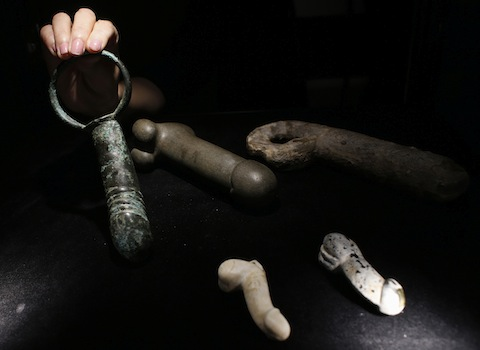 "Phalluses in stone, ceramic and bronze are displayed during a preview of an exhibition entitled ""Gardens of Pleasure: Sex in Ancient China"" in Hong Kong"